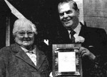 Library advocate Ada Dawe receiving a commemorative plaque from Premier W.A.C. Bennett at the dedication of Library improvements and of the archives, June 17, 1972.